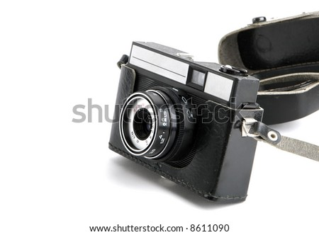 old 35mm camera on white - stock photo