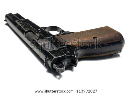 Old 9 mm pistol close up on white background. Clipping path (without shadow). - stock photo