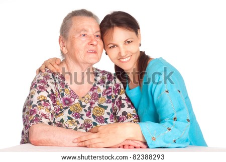 old mom with her daughter on white - stock photo