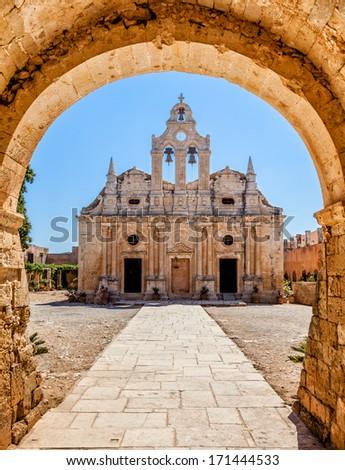 Old monastery behind the Arch. Arkadi monastery - Crete, Greece.  - stock photo