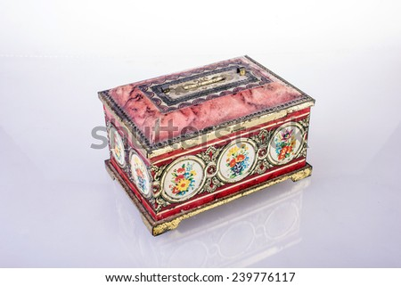 Old money saving box on white background - stock photo