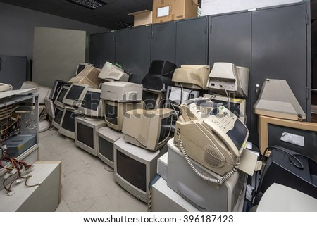 Old monitors and computer parts - stock photo