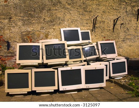 old monitors at the scrapyard for recycling - stock photo
