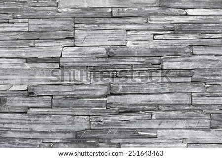 Old monochrome modern pattern of stone wall decorative surfaces . - stock photo