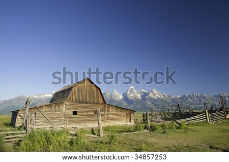 Old Mormon barn in Wyoming near the Tetons at sunrise - stock photo
