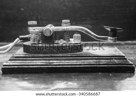 old morse key telegraph on wood table - stock photo