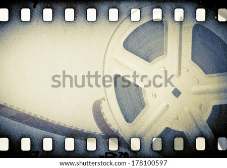 Old motion picture reel with film strip. - stock photo