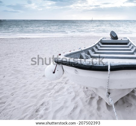 Old motor boat on a tropical beach. Summer vacation travel concept. Nautical fashion background - stock photo