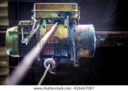 old motor to hook in an abandoned warehouse - stock photo