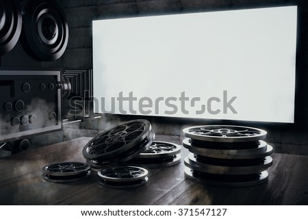 Old movie camera and film cartridge on a wooden table and a blank movie screen, mock up 3D Render - stock photo