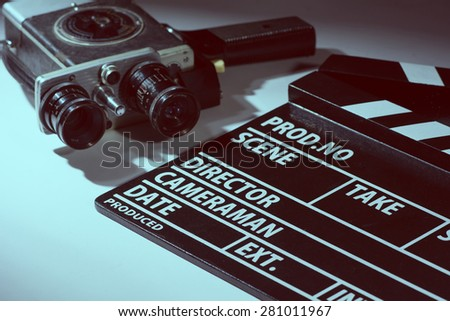 Old movie camera with film clapperboard. Preparations for shooting movie - stock photo