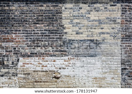 Old multi colored brick wall - stock photo