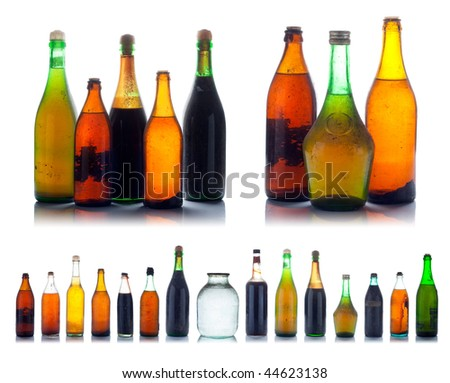 Old multicolored wine bottles set with natural dust and dirtiness - stock photo