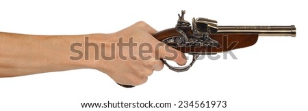 Old musket gun in male hand isolated on white background - stock photo