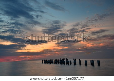 Old Naples Pier at sunset - stock photo