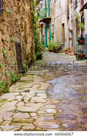 old narrow alley in tuscan village - antique italian lane - tuscany, italy - stock photo