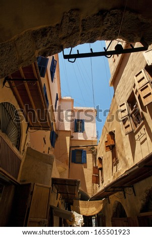 Old narrow street in Saida, Lebanon, Middle East, view from arc - stock photo