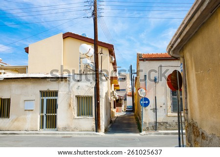 Old narrow street in the Mediterranean city with street road mirrors. - stock photo