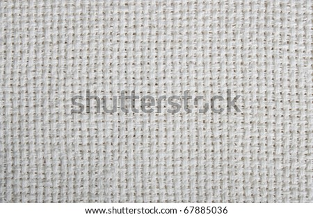 Old natural canvas texture used for background - stock photo