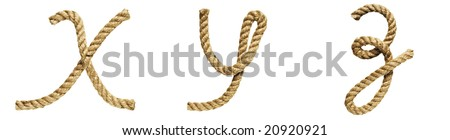 old natural fiber rope bent in the form of letter X, Y, Z - stock photo