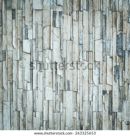 Old natural stone wall for background - stock photo