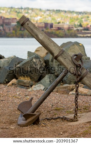 Old Navy Maritime Steel Anchor on Shore - stock photo