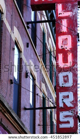 old neon liquors sign - stock photo