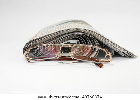 old newspapers and glasses - stock photo