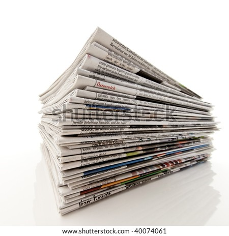 Old newspapers and magazines in a pile - stock photo
