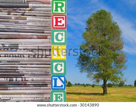 """Old newspapers with blocks spelling """"Recycle"""" dividing it into a nature scene with a green tree. - stock photo"""