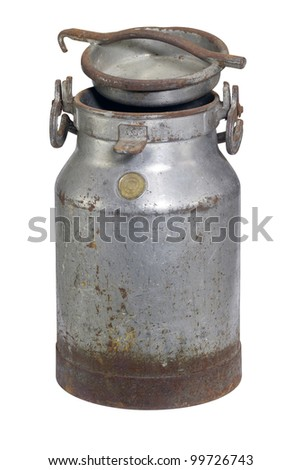 old nostalgic and corroded milk can with cap in white back - stock photo