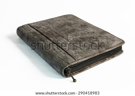 Old notebook's cover Isolated on White. Shallow dof. - stock photo