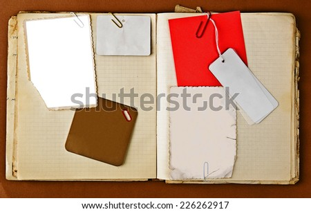 Old notebook with stained pages on brown paper surface. Useful for web site template design - stock photo