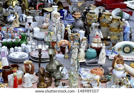 old objects for sale at a flea market - stock photo