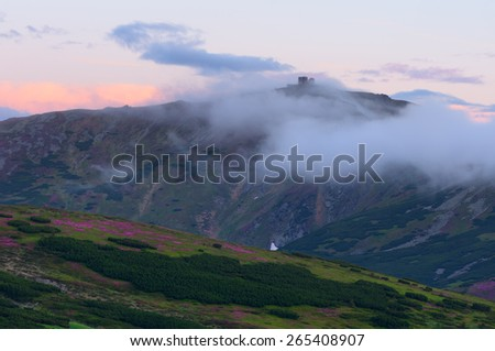 Old observatory on Mount. Mountains in the clouds. Summer landscape. Carpathians, Ukraine, Europe - stock photo