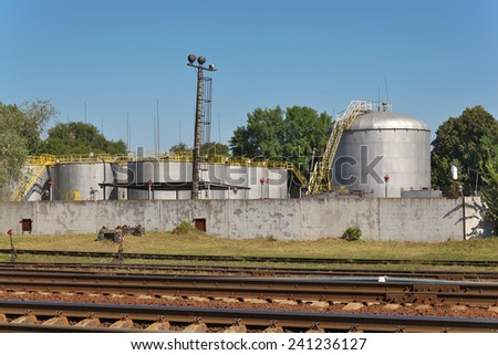 Old oil depot near the railway station - stock photo