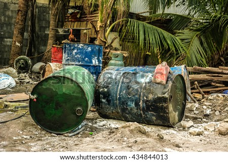 Old oil gallons tank barrels are already for recycle. - stock photo