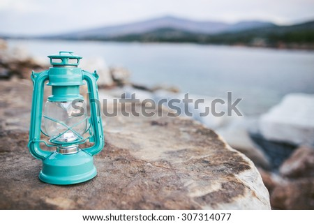 Old oil lanterns on the beach. Depth of field - stock photo