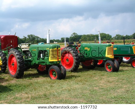 Old Oliver Farm Tractors at a Show - stock photo