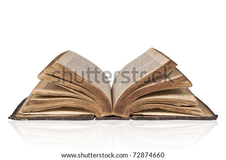 Old open antique bible isolated on white background with clipping path. - stock photo