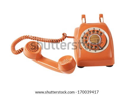 old orange telephone with rotary dial - stock photo