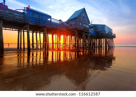 Old Orchard Beach pier at sunrise - stock photo