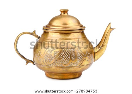 Old oriental metallic teapot on a white background - stock photo