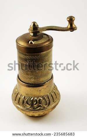 old oriental pepper mill on white background - stock photo