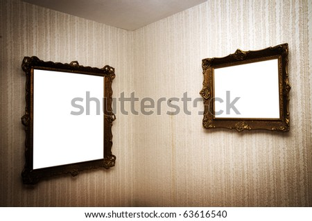 Old ornamented frames on retro grunge wall - stock photo