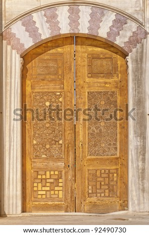 Old ornate wooden doors at the Suleiman mosque in istanbul, Turkey. - stock photo