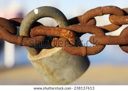 Old padlock holding together an old and rusty metal chain - stock photo