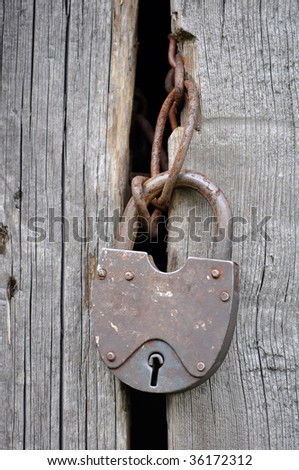 Old padlock on the door - stock photo