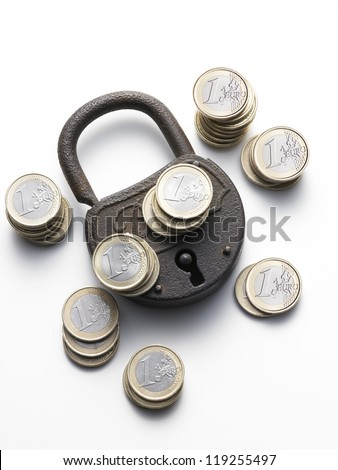 old padlock on white background with euro coins - stock photo