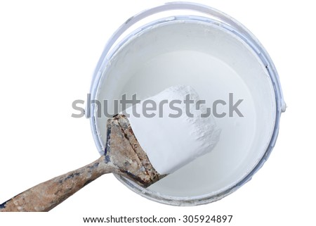 Old paint brush rest on top of  paint tin isolated in white background - stock photo